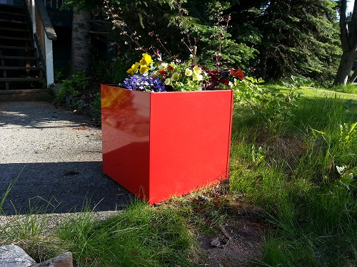 red metal planter