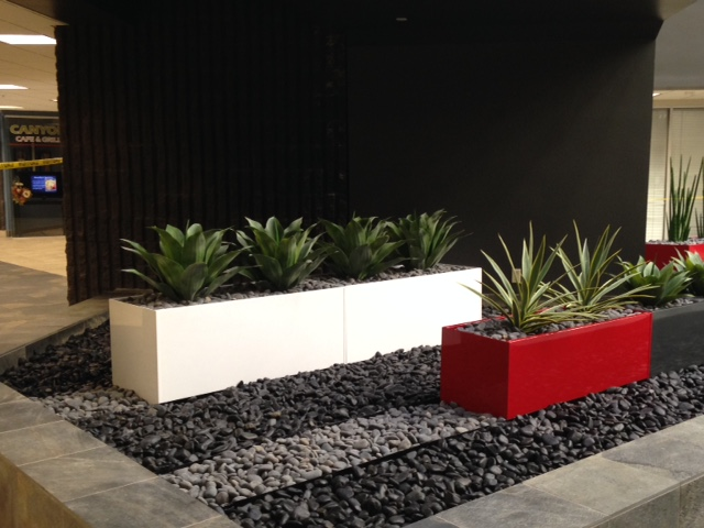 Rectangular powder coated aluminum planters with gravel rock Arizona