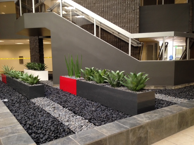 Rectangular powder coated aluminum planters with pebbles