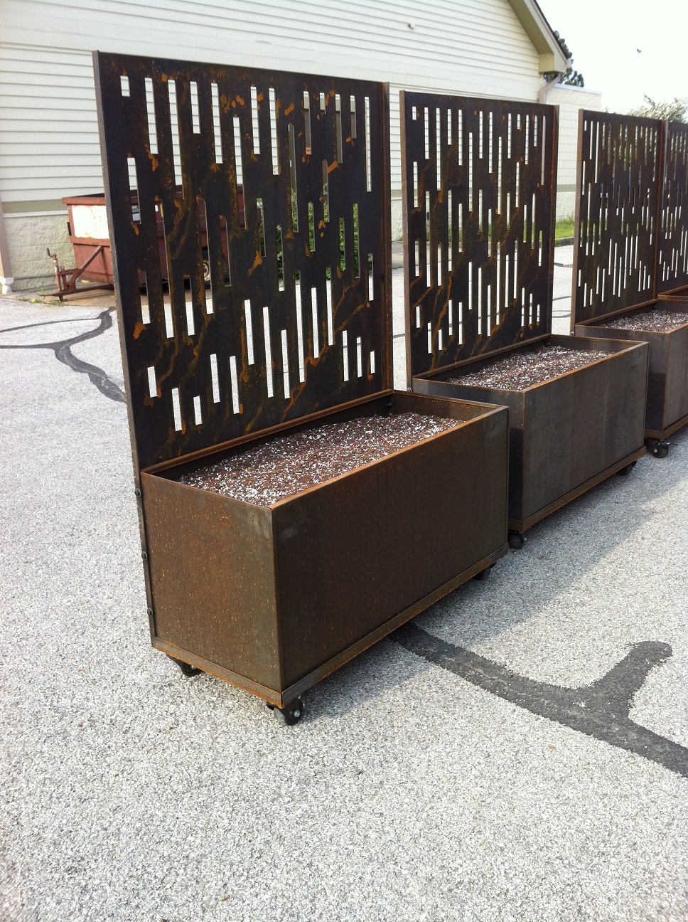 Here Are Some Of Our Nice Corten Planters On Casters With Screens Mounted To The Planter Box